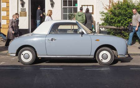 sixties: STRATFORD UPON AVON, UK - SEPTEMBER 26, 2015: Figaro is a small retro car manufactured by Nissan resembling the aesthetics of the sixties cars