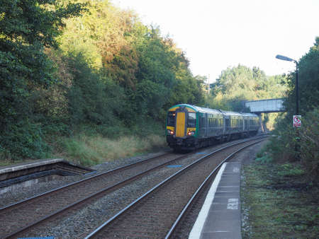 arden: TANWORTH IN ARDEN, UK - SEPTEMBER 26, 2015: London Midland train at Wood End railway station on the Stratford upon Avon to Birmingham route known at the Shakespeare Line