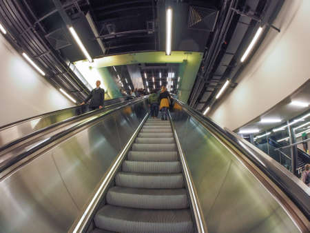 powerstation: LONDON, UK - SEPTEMBER 28, 2015: Tourists visiting the Tate Modern art gallery in South Bank powerstation seen with fisheye lens