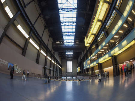 public space: LONDON, UK - SEPTEMBER 28, 2015: The Turbine Hall once housed the electricity generators of the power station now a public space part of Tate Modern art gallery in South Bank seen with fisheye lens