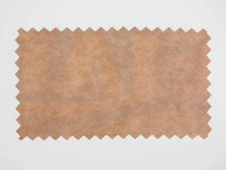 zig zag: Brown paper swatch with zig zag border cut with pinking shears
