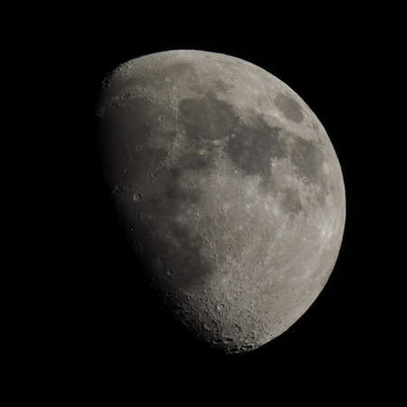 seen: Gibbous moon over dark black sky seen with a telescope from northern emisphere at night Stock Photo