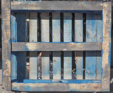 skid: Blue wooden pallet or skid