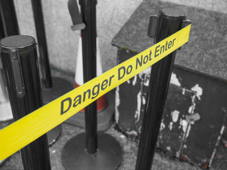 do not enter: Yellow band fence danger do not enter warning sign Stock Photo