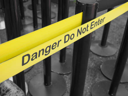 do not enter: Yellow band fence danger do not enter warning sign Stock Photo