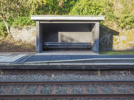 railway: Outdoor waiting room shed at rural railway station in UK