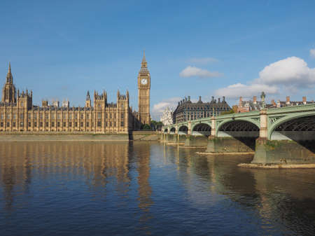westminster bridge: Houses of Parliament aka Westminster Palace and Westminster Bridge over River Thames in London, UK