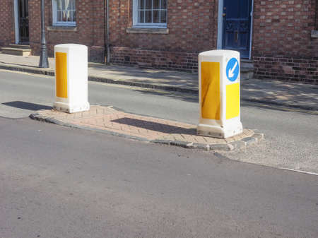 obstruct: Traffic bollard short vertical post to control or direct road traffic and obstruct the passage of motor vehicles