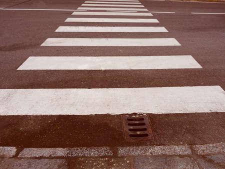 zebra crossing: Vintage looking Zebra crossing sign at pedestrian crossroad Stock Photo