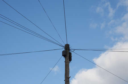 telephony: Telecommunications pole with telephone wires for telephony and internet