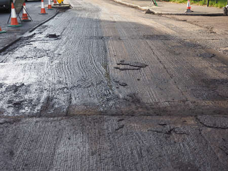 asphalt paving: Paving works to remove and lay new tarmac asphalt on a road Stock Photo