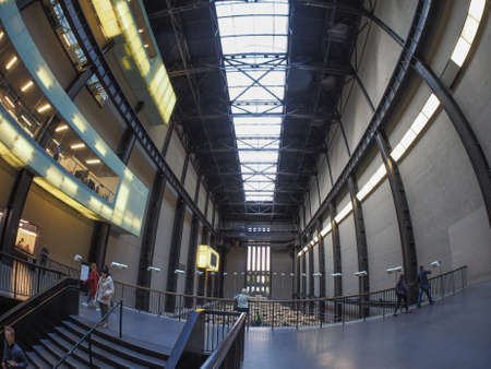 housed: LONDON, UK - SEPTEMBER 28, 2015: The Turbine Hall once housed the electricity generators of the power station now a public space part of Tate Modern art gallery in South Bank seen with fisheye lens