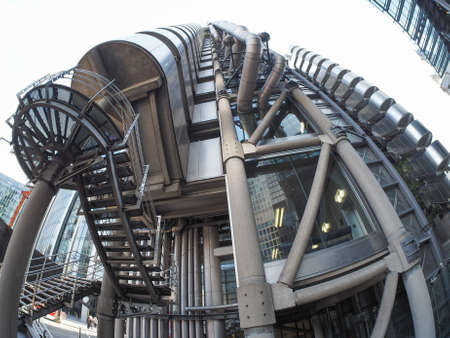 richard: LONDON, UK - SEPTEMBER 29, 2015: Lloyd of London is an iconic high tech skyscraper designed by architect Richard Rogers seen with fisheye lens Editorial