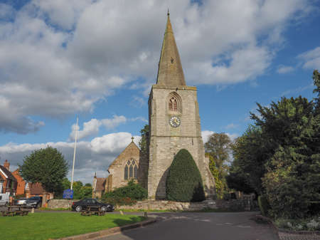 arden: TANWORTH IN ARDEN, UK - SEPTEMBER 25, 2015: The Village Green with St Mary Magdalene church