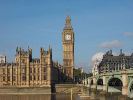 westminster bridge: LONDON, UK - SEPTEMBER 28, 2015: Tourists on Westminster Bridge at the Houses of Parliament aka Westminster Palace