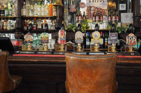 beers: LONDON, UK - SEPTEMBER 28, 2015: Draught cask beers in a traditional English Pub