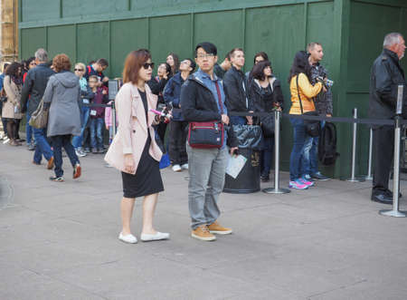 visiting: LONDON, UK - SEPTEMBER 28, 2015: Tourists visiting central London Editorial