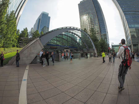 serves: LONDON, UK - SEPTEMBER 29, 2015: The Canary Wharf tube station serves the largest business district in the United Kingdom