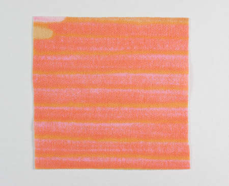 swatch: Orange fabric swatch over white background