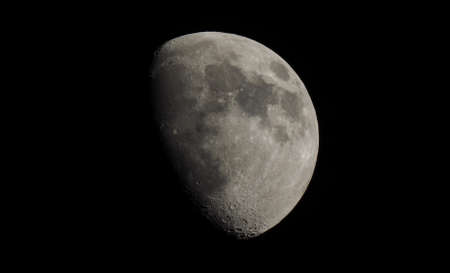 astrophoto: Gibbous moon over dark black sky seen with a telescope from northern emisphere at night Stock Photo