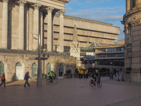 venue: BIRMINGHAM, UK - SEPTEMBER 25, 2015: Tourists in front of Town Hall concert venue and Public Library Editorial