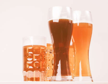 Vintage looking Many glasses of German beers including weiss dunkel and lager Stock Photo