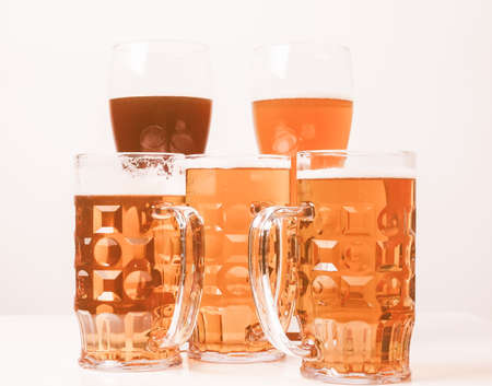 pilsner glass: Vintage looking Many glasses of German beers including weiss dunkel and lager Stock Photo