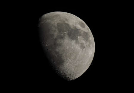 gibbous: Gibbous moon over dark black sky seen with a telescope from northern emisphere at night Stock Photo
