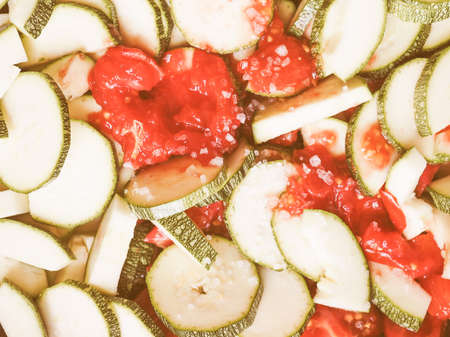 courgettes: Vintage looking Courgettes vegetables with tomato sauce useful as a background