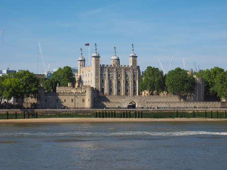 dungeons: The Tower of London seen from River Thames in London, UK
