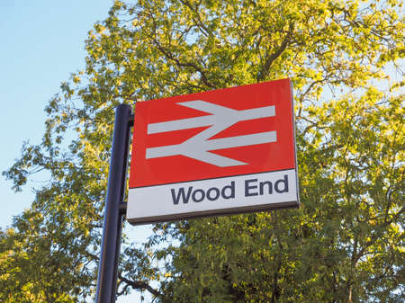 wood railway: TANWORTH IN ARDEN, UK - SEPTEMBER 25, 2015: Wood End railway station sign
