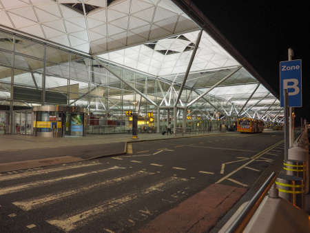 foster: STANSTED, UK - SEPTEMBER 29, 2015: London Stansted airport design by architect Lord Norman Foster at night Editorial