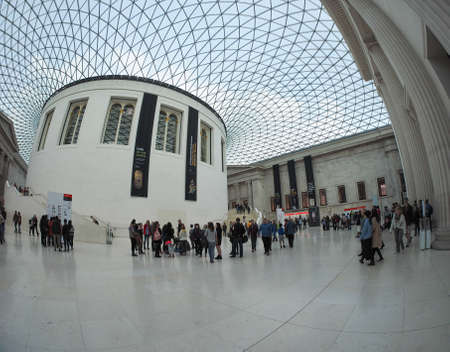 foster: LONDON, UK - SEPTEMBER 28, 2015: Tourists in the Great Court at the British Museum designed by architect Lord Norman Foster opened in year 2000 seen with fisheye lens Editorial
