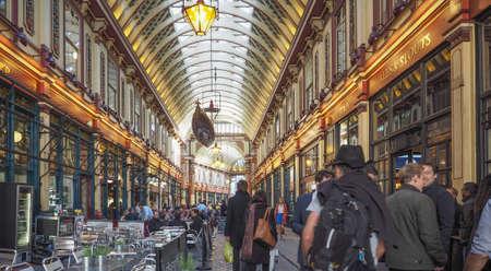 uk cuisine: LONDON, UK - SEPTEMBER 29, 2015: Tourists in Leadenhall Market covered market on Gracechurch Street Editorial