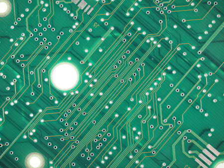 etched: Detail of an electronic printed circuit board useful as a background