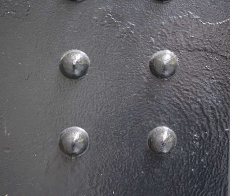 steel texture: Black steel texture useful as a background with bolts
