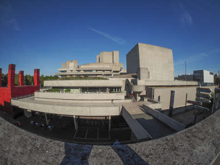 sir: LONDON, UK - SEPTEMBER 28, 2015: The National Theatre designed by Sir Denys Lasdun is a masterpiece of new brutalist architecture seen with fisheye lens
