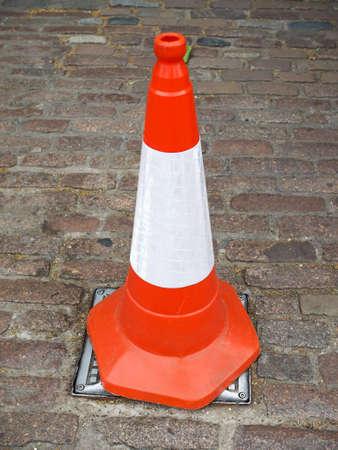 roadworks: Orange and white traffic cone for roadworks Stock Photo