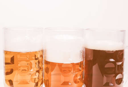 weiss: Vintage looking Many glasses of German beers including weiss dunkel and lager Stock Photo