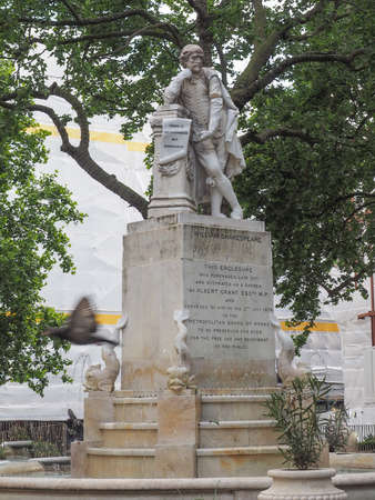 Statue of William Shakespeare built in 1874 in Leicester Square in London, UK