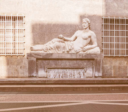 dora: Vintage looking Statue of river Dora in Turin Italy Editorial