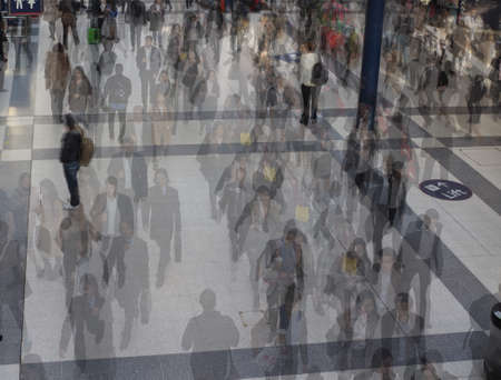 lapse: LONDON, UK - SEPTEMBER 28, 2015: Travellers at Liverpool Street Station multi exposure time lapse