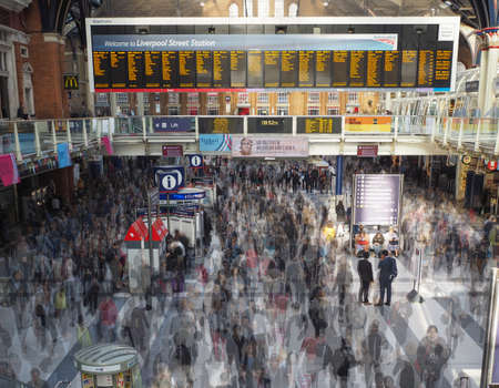 time lapse: LONDON, UK - SEPTEMBER 28, 2015: Travellers at Liverpool Street Station multi exposure time lapse