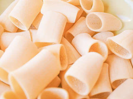 maccheroni: Vintage looking Italian paccheri pasta in the shape of large tubes from Campania and Calabria