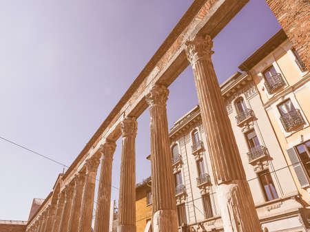 lawrence: Vintage looking MILAN, ITALY - MARCH 28, 2015: Colonne di San Lorenzo meaning St Lawrence columns, ancient Roman ruins Milan Italy