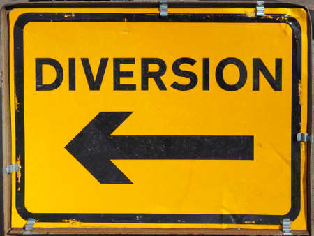 diversion: Traffic sign for road diversion in black over yellow