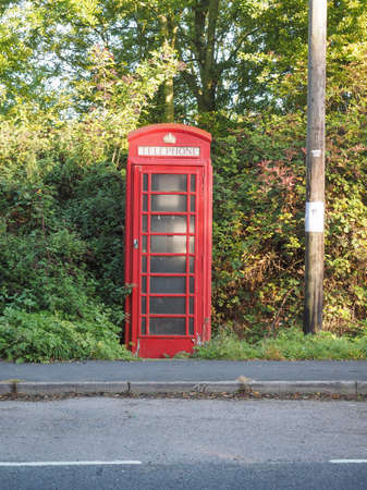 red telephone: Traditional red telephone box in the country in England UK Stock Photo