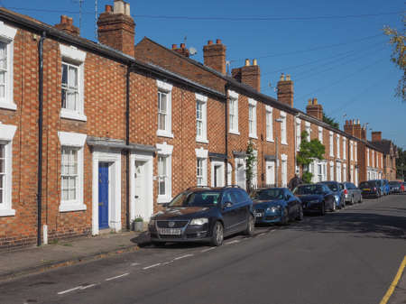 typically british: STRATFORD UPON AVON, UK - SEPTEMBER 26, 2015: A row of typically British terraced houses aka townhouse