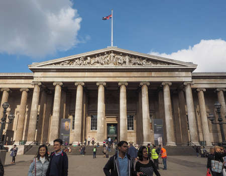 visiting: LONDON, UK - SEPTEMBER 28, 2015: Tourists visiting the British Museum