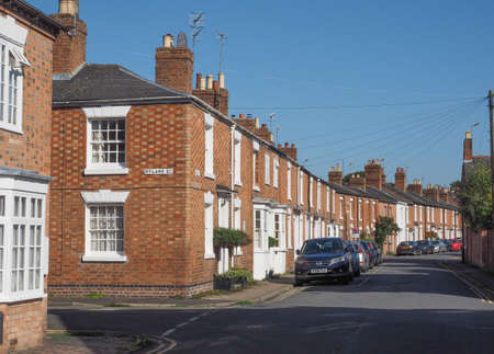 typically british: STRATFORD UPON AVON, UK - SEPTEMBER 26, 2015: A row of typically British terraced houses aka townhouses